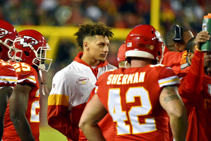 FILE - In this Oct. 27, 2019, file photo, Kansas City Chiefs quarterback Patrick Mahomes follows the first half of an NFL football game against the Green Bay Packers from the sidelines, in Kansas City, Mo. Starting with Andrew Luck, who retired at age 29 after dealing with a series of injuries, so many star quarterbcks have been hurt that it's hard to keep track of who's confined to the sidelines. (AP Photo/Ed Zurga, File)