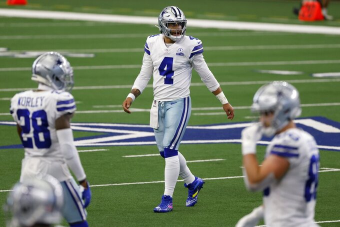 Dallas Cowboys cornerback Daryl Worley (28) and quarterback Dak Prescott (4) walks to the sideline after Prescott threw an incomplete pass in the second half of an NFL football game against the Cleveland Browns in Arlington, Texas, Sunday, Oct. 4, 2020. (AP Photo/Ron Jenkins)