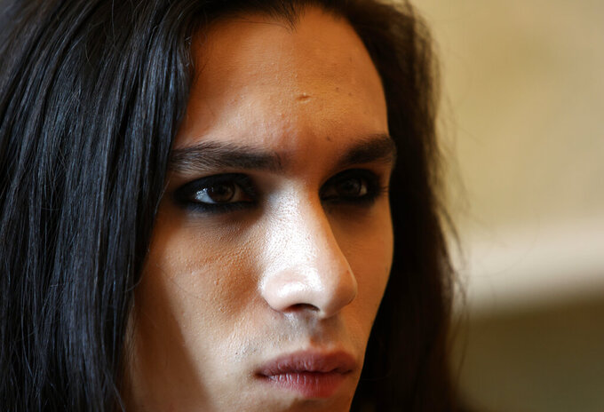 Ethan Torchio, drummer of Italian band Maneskin, winners of the Eurovision Song Contest in May, listens during an interview with the Associated Press at a hotel in Rome, Tuesday, July 27, 2021. (AP Photo/Riccardo De Luca)