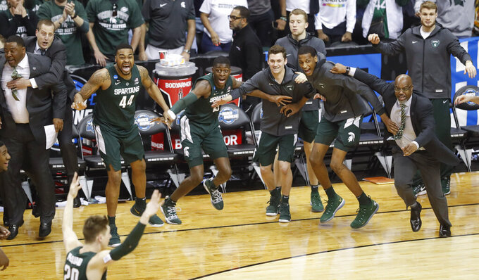 Michigan State players begin to celebrate their win over Duke at the end of the NCAA men's East Regional final collage basketball game in Washington, Sunday, March 31, 2019. (AP Photo}