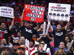 Fans hold signs about Hong Kong during the second half of an NBA basketball game between the Houston Rockets and the Milwaukee Bucks, Thursday, Oct. 24, 2019, in Houston. (AP Photo/Eric Christian Smith)