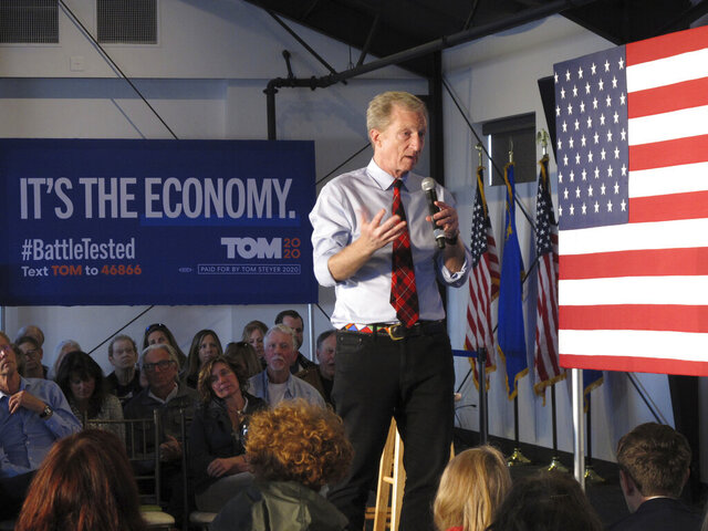 Democratic presidential hopeful Tom Steyer speaks at a rally in west Reno, Nev., Wednesday, Feb. 12, 2020, before his three-day bus tour through Nevada heads to Las Vegas on Thursday. The California billionaire says he's poised to