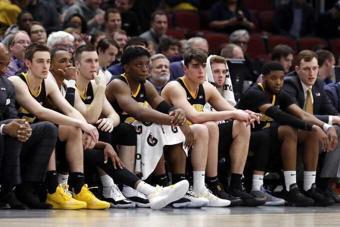 Iowa bench watch during the second half of an NCAA college basketball game against Michigan in the quarterfinals of the Big Ten Conference tournament, Friday, March 15, 2019, in Chicago. Michigan won 74-53. (AP Photo/Nam Y. Huh)