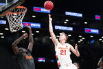 Syracuse forward Marek Dolezaj (21) goes to the basket against Oklahoma State forward Yor Anei (14) during the second half of an NCAA college semi final basketball game in the NIT Season Tip-Off tournament, Wednesday, Nov. 27, 2019, in New York. Oklahoma State won 86-72. (AP Photo/Mary Altaffer)