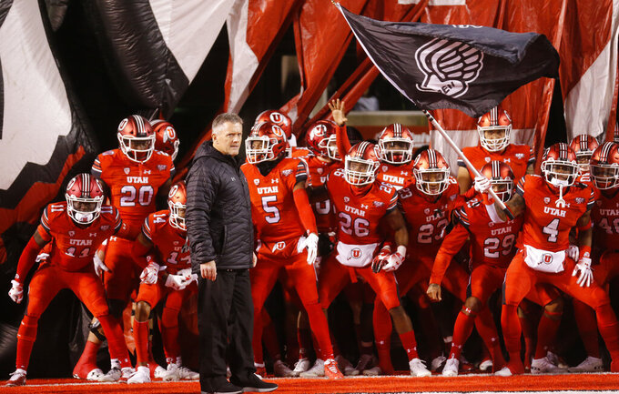 FILE - In this Nov. 24, 2018, file photo, Utah head coach Kyle Whittingham and his team prepares to take the field prior to an NCAA college football game against the BYU in Salt Lake City. The 14th-ranked Utes return their entire two-deep front from last season, including Leki Fotu and defensive end Bradlee Anae, who both graded well enough to project as early round picks in the 2019 NFL draft.  (AP Photo/Rick Bowmer, File)
