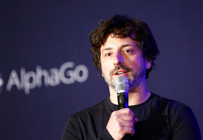 FILE- In this March 12, 2016, file photo Google co-founder Sergey Brin speaks during a press conference after finishing the third match of the Google DeepMind Challenge Match in Seoul, South Korea. Google co-founders Larry Page and Brin are stepping down from their roles within the parent company, Alphabet. Page, who had been serving as CEO of Alphabet, and Brin, who had been president of Alphabet, will remain on the board of the company. (AP Photo/Lee Jin-man, File)