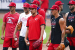 Cincinnati Reds pitcher Trevor Bauer (center) stands with other members of the pitching staff during team baseball practice at Great American Ballpark in Cincinnati, Wednesday, July 8, 2020. (AP Photo/Bryan Woolston)