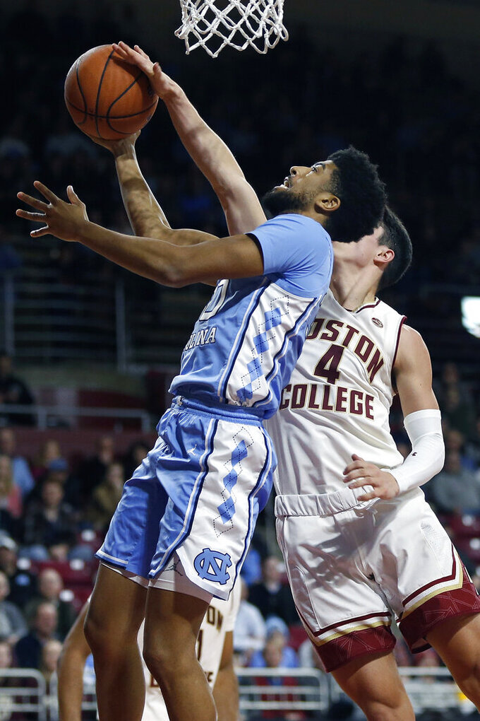 Boston College's Chris Herren Jr. (4) blocks a shot by North Carolina's K.J. Smith during the second half of an NCAA college basketball game in Boston, Tuesday, March 5, 2019. (AP Photo/Michael Dwyer)
