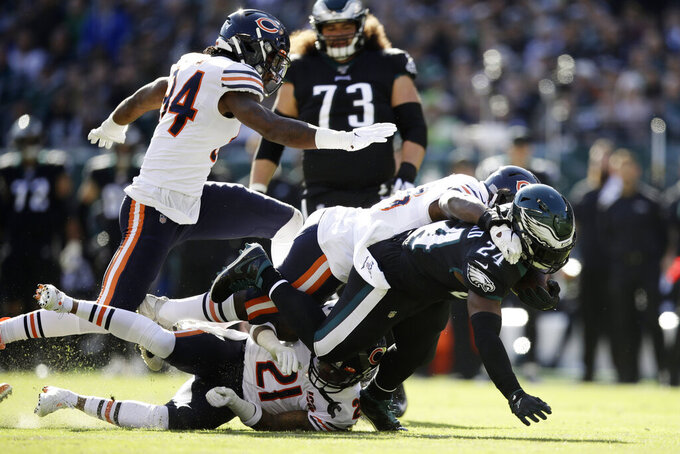 Philadelphia Eagles' Jordan Howard (24) is tackled by Chicago Bears' Roquan Smith (58) during the first half of an NFL football game, Sunday, Nov. 3, 2019, in Philadelphia. (AP Photo/Matt Rourke)