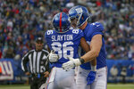 New York Giants wide receiver Darius Slayton (86) celebrates with offensive tackle Nate Solder (76) after scoring a touchdown against the Miami Dolphins during the third quarter of an NFL football game, Sunday, Dec. 15, 2019, in East Rutherford, N.J. (AP Photo/Seth Wenig)