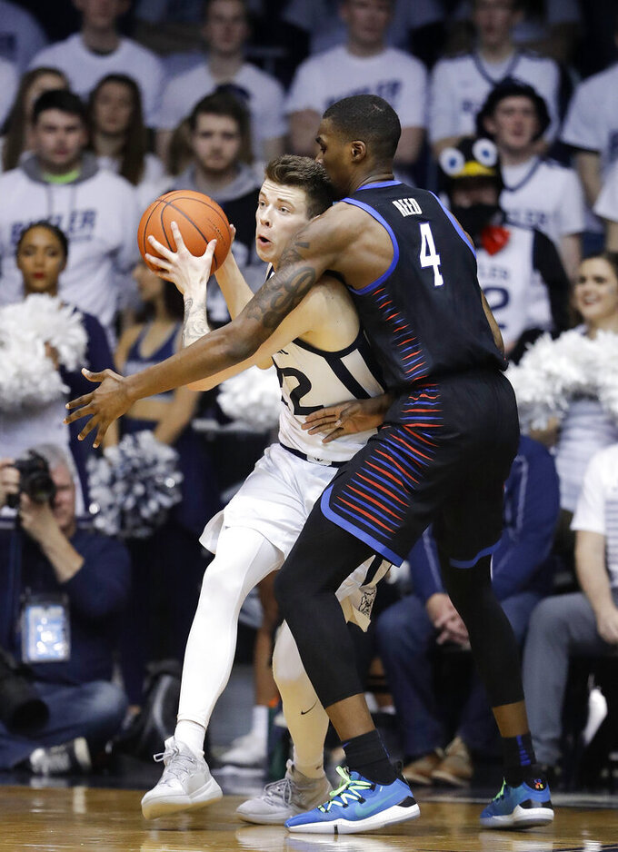 Butler's Sean McDermott, left, is defended by DePaul's Paul Reed (4) during the second half of an NCAA college basketball game, Saturday, Feb. 16, 2019, in Indianapolis. (AP Photo/Darron Cummings)