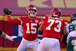 Kansas City Chiefs quarterback Patrick Mahomes (15) throws a pass as guard Nick Allegretti (73) helps against pressure from New York Jets defensive tackle Quinnen Williams, right, in the second half of an NFL football game on Sunday, Nov. 1, 2020, in Kansas City, Mo. (AP Photo/Charlie Riedel)