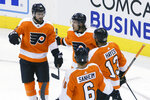 Philadelphia Flyers center Scott Laughton (21) celebrates his goal alongside teammates Travis Konecny (11), Kevin Hayes (13) and Travis Sanheim (6) during the third period of an NHL hockey playoff game  Thursday, Aug. 6, 2020, in Toronto. (Cole Burston/The Canadian Press via AP)