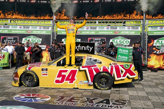 Kyle Busch celebrates in Victory Lane after winning a NASCAR Xfinity Series auto race at Texas Motor Speedway in Fort Worth, Texas, Saturday, June 12, 2021. (AP Photo/Tony Gutierrez)