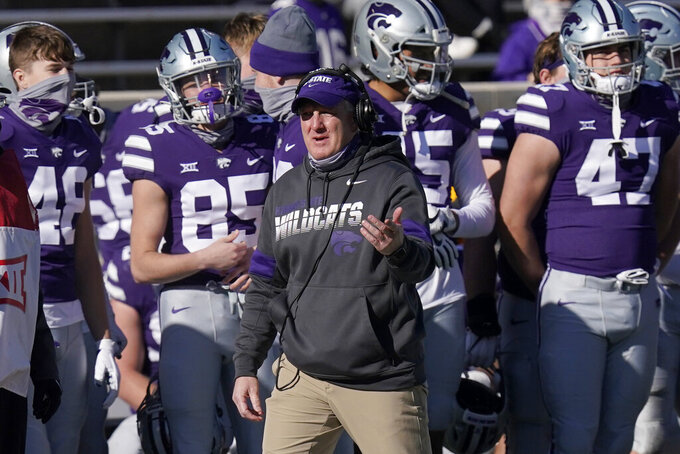 Kansas State head coach Chris Klieman directs his team during the first half of an NCAA college football game against Texas in Manhattan, Kan., Saturday, Dec. 5, 2020. (AP Photo/Orlin Wagner)