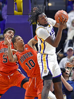 LSU forward Naz Reid (0) pulls down an offensive rebound in front of Auburn guard Samir Doughty (10) and Auburn forward Chuma Okeke (5) in the second half of an NCAA college basketball game, Saturday, Feb. 9, 2019, in Baton Rouge, La. LSU won 83-78. (AP Photo/Bill Feig)