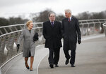 FILE - In this March 5, 2014 file photo former US President Bill Clinton, right, with former Social Democratic Labour Party leader John Hume and Hume's wife Pat walk across the Peace Bridge, in Londonderry Northern Ireland. The family of politician John Hume, who won Nobel Peace Prize for work to end violence in Northern Ireland, says he has died. He was 83. The Catholic leader of the moderate Social Democratic and Labour Party , Hume was regarded by many as the principal architect behind the peace agreement. (AP Photo/Peter Morrison)