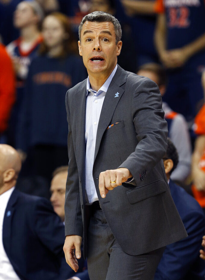 Virginia head coach Tony Bennett directs his team during the first half of an NCAA college basketball game against Notre Dame, in Charlottesville, Va., Saturday, Feb. 16, 2019. Virginia defeated Notre Dame 60-54. (AP Photo/Steve Helber)