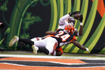 Cleveland Browns' David Njoku, top, makes a touchdown reception against Cincinnati Bengals' Vonn Bell (24) during the second half of an NFL football game, Sunday, Oct. 25, 2020, in Cincinnati. (AP Photo/Michael Conroy)