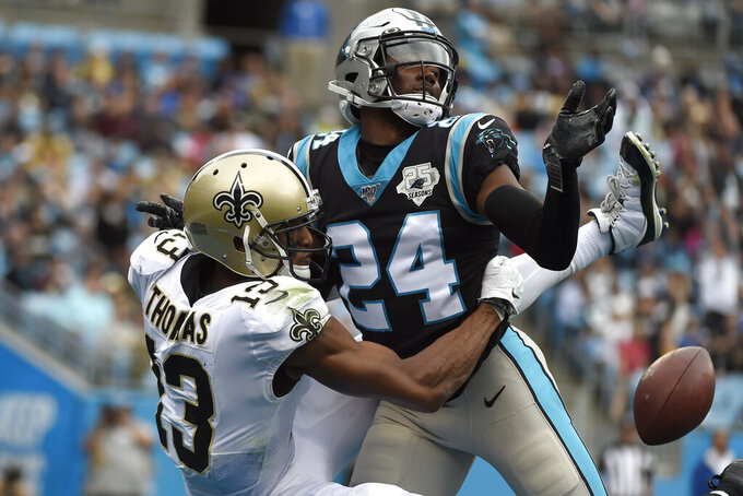 FILE - In this Sunday, Dec. 29, 2019, file photo, then-Carolina Panthers cornerback James Bradberry, right, breaks up a pass intended for New Orleans Saints wide receiver Michael Thomas (13) during the first half of an NFL football game in Charlotte, N.C. As the Giants and new coach Joe Judge get ready for their first training camp practice on Monday, Aug. 17, the one certainty is recent free agent signee James Bradberry will be one of the cornerbacks. The former Carolina Panther is one of the best in the league and gives New York a lock-down guy. (AP Photo/Mike McCarn, File)