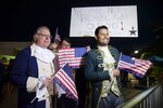 Dan Santiago, right, and Miguel Gallo, left, hold a demonstration in favor of statehood at the entrance plaza of the Santurce Fine Arts Center moments before the premiere of the award-winning Broadway musical, Hamilton, starring its creator, New York native of Puerto Rican descent Lin-Manuel Miranda, in San Juan, Puerto Rico, Friday Jan. 11, 2019. The musical is set to run for two weeks and will raise money for local arts programs. (AP Photo/Carlos Giusti)
