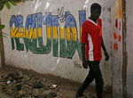 Graffiti by Sudanese opposition is painted on a wall near the defense ministry, in Khartoum, Sudan, Wednesday, June 19, 2019. Sudan's military council is urging protest leaders to resume negotiations on the transition of power, but says talks