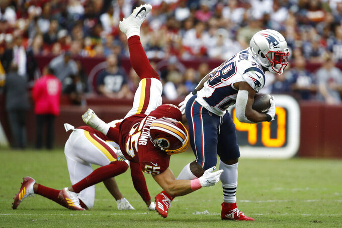 Washington Redskins linebacker Cassanova McKinzy (58) tackles New England Patriots running back James White (28) during the second half of an NFL football game, Sunday, Oct. 6, 2019, in Washington. (AP Photo/Patrick Semansky)