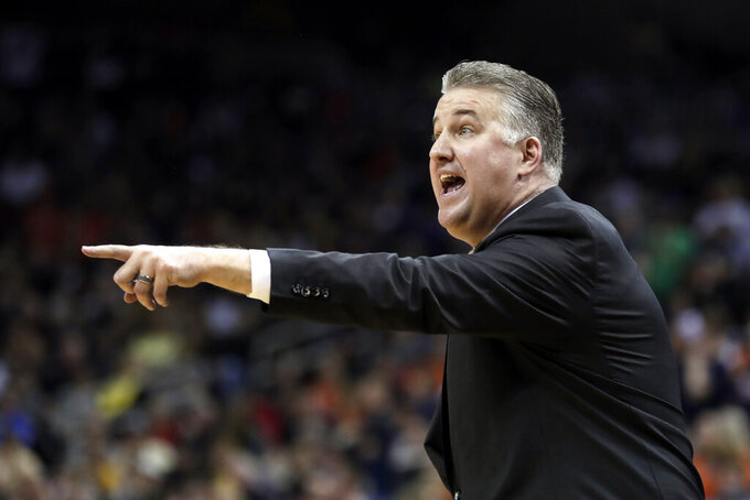 Purdue head coach Matt Painter yells from the sidelines during the first half of the men's NCAA Tournament college basketball South Regional final game against Virginia, Saturday, March 30, 2019, in Louisville, Ky. (AP Photo/Michael Conroy)