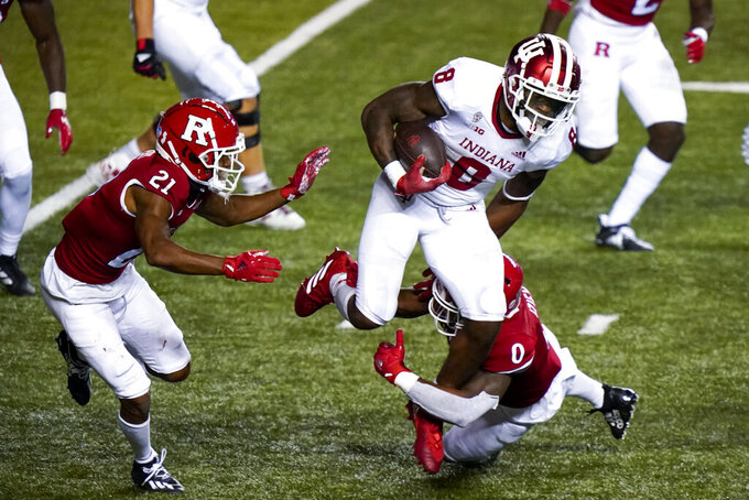 Rutgers defensive backs Tre Avery (21) and Christian Izien (0) bring down Indiana running back Stevie Scott III (8) in the fourth quarter of an NCAA college football game, Saturday, Oct. 31, 2020, in Piscataway, N.J. (AP Photo/Corey Sipkin)