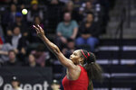 United States' Serena Williams tosses the ball for a serve to Latvia's Jelena Ostapenko during a Fed Cup qualifying tennis match Friday, Feb. 7, 2020, in Everett, Wash. (AP Photo/Elaine Thompson)