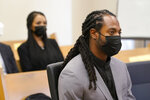 NFL football player Richard Sherman, right, sits in King County District Court as his wife Ashley Sherman, left, looks on during a hearing Friday, July 16, 2021, in Seattle. Prosecutors in Washington state have charged Sherman, who has played for the Seattle Seahawks and the San Francisco 49ers, after police said he drunkenly crashed his SUV in a construction zone and tried to break into his in-laws' home. (AP Photo/Ted S. Warren)