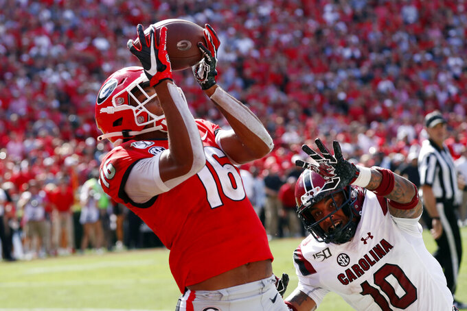Georgia wide receiver Demetris Robertson (16) catches a pass for a touchdown as South Carolina defensive back R.J. Roderick (10) defends in the second half of an NCAA college football game Saturday, Oct. 12, 2019, in Athens, Ga. (AP Photo/John Bazemore)