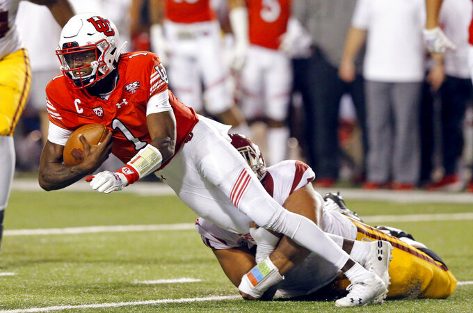 Southern California defensive lineman Marlon Tuipulotu (51) sacks Utah quarterback Tyler Huntley (1) during the first half of an NCAA college football game Saturday, Oct. 20, 2018, in Salt Lake City. (AP Photo/Rick Bowmer)