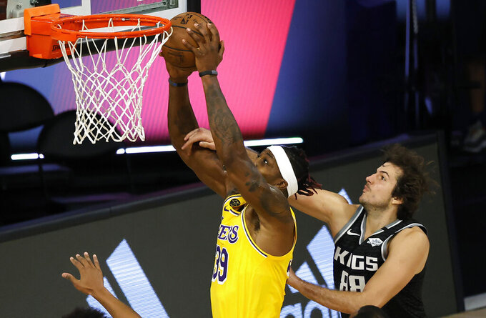 Los Angeles Lakers' Dwight Howard (39) is fouled by Sacramento Kings' Nemanja Bjelica (88) during the second quarter of an NBA basketball game Thursday, Aug. 13, 2020, in Lake Buena Vista, Fla. (Kevin C. Cox/Pool Photo via AP)