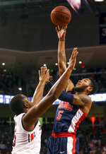 Mississippi guard Markel Crawford (5) puts up a shot over Auburn guard Mustapha Heron (5) during the first half of an NCAA college basketball game, Tuesday, Jan. 9, 2018, in Auburn, Ala. (AP Photo/Butch Dill)
