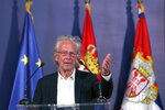 Austrian author Peter Handke speaks during a ceremony after receives the Order of the Karadjordje's Star from Serbian President Aleksandar Vucic in Belgrade, Serbia, Sunday, May 9, 2021. Serbia has decorated Austrian Nobel literature laureate Peter Handke, who is known for his apologist views over Serb war crimes during the 1990s' wars in the Balkans. (AP Photo/Darko Vojinovic)