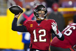 Tampa Bay Buccaneers quarterback Tom Brady (12) throws a pass during the second half of an NFL wild-card playoff football game against the Washington Football Team, Saturday, Jan. 9, 2021, in Landover, Md. (AP Photo/Julio Cortez)