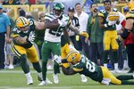 New York Jets' Brandin Echols returns an interception during the second half of a preseason NFL football game against the Green Bay Packers Saturday, Aug. 21, 2021, in Green Bay, Wis. (AP Photo/Mike Roemer)