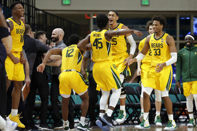 Baylor players celebrate after defeating Villanova in an NCAA college basketball championship game at the Myrtle Beach Invitational in Conway, S.C., Sunday, Nov. 24, 2019. (AP Photo/Gerry Broome)