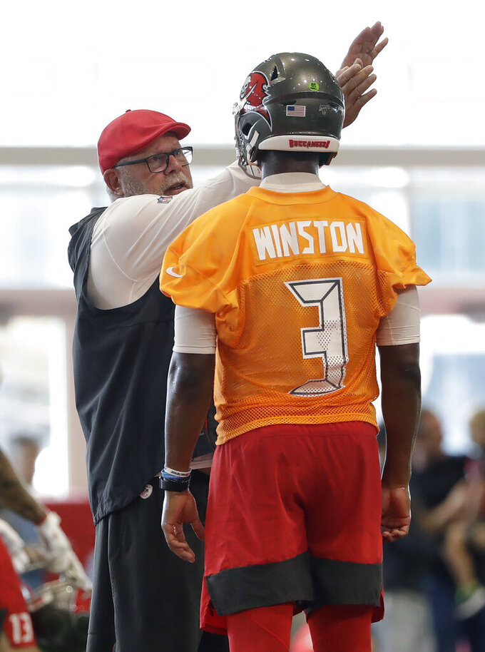 Tampa Bay Buccaneers head coach Bruce Arians talks to quarterback Jameis Winston (3) during an NFL football training camp practice Friday, July 26, 2019, in Tampa, Fla. (AP Photo/Chris O'Meara)