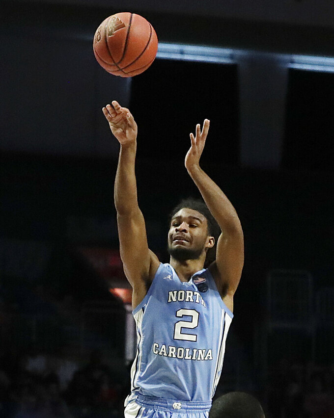 North Carolina guard Coby White shoots during the first half of an NCAA college basketball game against Miami, Saturday, Jan. 19, 2019, in Coral Gables, Fla. (AP Photo/Brynn Anderson)