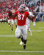 Georgia wide receiver Tyler Simmons (87) reacts a s scores a touchdown after a catch during the first half of an NCAA college football game against Massachusetts Saturday, Nov. 17, 2018, in Athens, Ga. (AP Photo/John Bazemore)