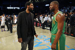 Brooklyn Nets guard Kyrie Irving, left, talks with Boston Celtics guard Kemba Walker after their NBA basketball game Friday, Nov. 29, 2019, in New York. The Nets won 112-107. (AP Photo/Adam Hunger)