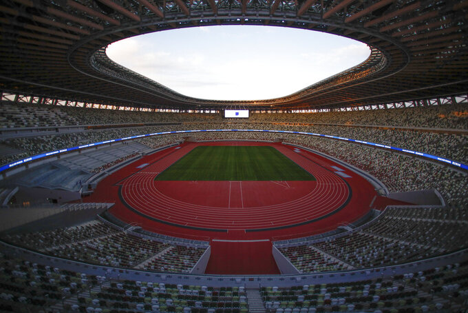 """FILE - This Dec. 15, 2019, file photo shows the Japan National Stadium in Tokyo. Tokyo pitched itself as """"a safe pair of hands"""" when it was awarded the Olympics 7 1/2 years ago. Now, nothing is certain as Tokyo's postponed Olympics hit the 100-days-to-go mark on Wednesday, April 14, 2021. (AP Photo/Jae C. Hong, File)"""