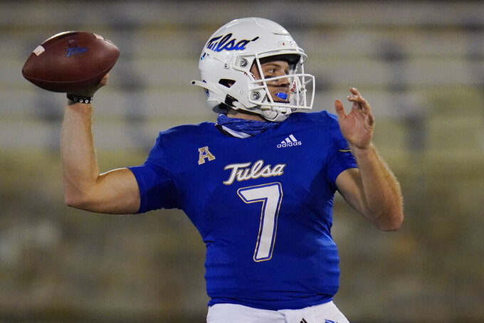 Tulsa quarterback Davis Brin throws a pass against Tulane during the second half of an NCAA college football game in Tulsa, Okla., Thursday, Nov. 19, 2020. (AP Photo/Sue Ogrocki)
