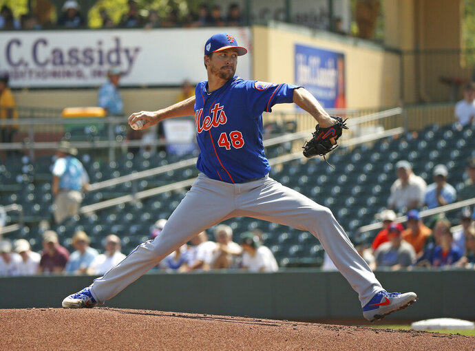 New York Mets pitcher Jacob deGrom (48) pitches during the first inning of a spring training baseball game against the Miami Marlins, Tuesday, March 12, 2019 in Jupiter, Fla. (David Santiago/Miami Herald via AP)