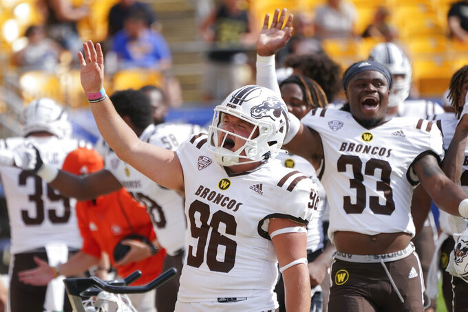 Western Michigan long snapper Bryce Bouwens (96) and linebacker Quinton Cannon (33) celebrate after defeating Pittsburgh in an NCAA college football game, Saturday, Sept. 18, 2021, in Pittsburgh. Western Michigan won 44-41.(AP Photo/Keith Srakocic)
