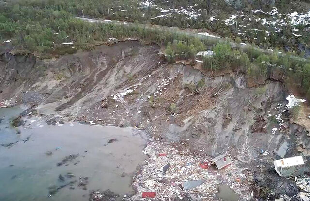 The scene of a landslide near Alta, Arctic Norway, seen Wednesday June 3, 2020, after a powerful landslide that took eight houses into the sea off northern Norway. Police spokesman Torfinn Halvari said a car was taken in the landslide but no people injured. (Anders Bjordal via AP)