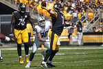 Pittsburgh Steelers quarterback Ben Roethlisberger (7) throws a pass under pressure by Las Vegas Raiders defensive end Maxx Crosby (98) during the first half of an NFL football game in Pittsburgh, Sunday, Sept. 19, 2021. (AP Photo/Keith Srakocic)
