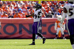Baltimore Ravens linebacker Odafe Oweh (99) celebrates his sack against the Denver Broncos during the first half of an NFL football game, Sunday, Oct. 3, 2021, in Denver. (AP Photo/David Zalubowski)